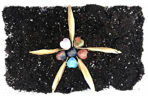 Star image from feathers and heart stones